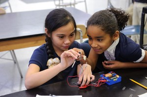 Fourth-graders perform an experiment with electromagnets at Dr. Joseph S. Renzulli Gifted and Talented Academy in Hartford on Dec. 14, 2011. (Peter Morenus/UConn Photo)