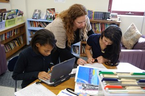 Sixth-graders work on writing projects with teacher Kim Albro '99 (ED), '00 MA. (Peter Morenus/UConn Photo)