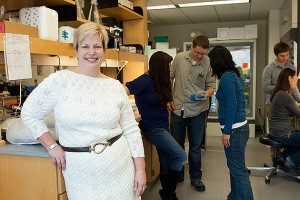 Molecular and cell biology professor Carolyn Teschke, foreground, with her research group. (Daniel Buttrey/UConn Photo)