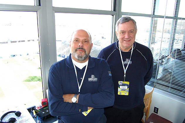 Joe D'Ambrosio, left, and Wayne Norman, in the WTIC/UConn Radio Networkbooth high above Rentschler Field.