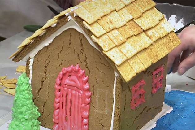 Gingerbread house being built.
