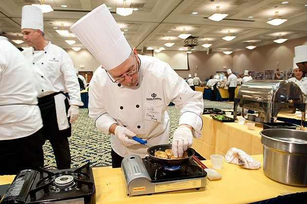Charlie String of the South Marketplace checks his skillet during the 12th Annual Culinary Competition held at the Rome Commons Ballroom on Jan. 12, 2012. (Peter Morenus/UConn Photo)