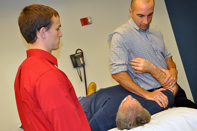 Current DPT Student Gregory Sabo gets hands-on instruction from UConn Health Center physical therapist Gregg Gomlinski as part of his clinical experience. (Shawn Kornegay/UConn Photo)