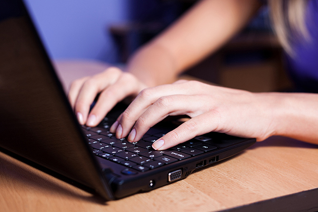 Person typing on a laptop.