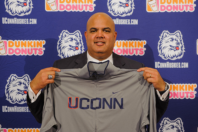Warde Manuel holds a UConn jacket at a press conference to announce his appointment as athletic director, held at the Burton Family Football Complex on Feb. 13. (Peter Morenus/UConn Photo)
