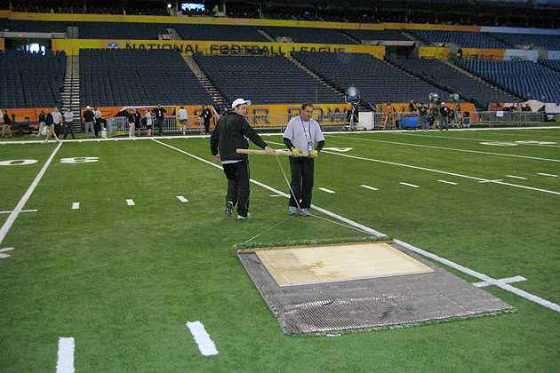 Mike Sargent, left, helps drag the field in preparation for the 'big day.' (Photo courtesy of Toro)