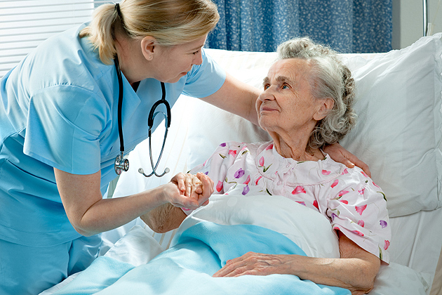 Nurse attending to an elderly person.