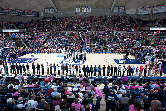 More than 300 Student-athletes who have attained at least a 3.0 grade-point average within the past academic year surround the basketball court in Gampel Pavilion after being recognized by President Susan Herbst and Provost Peter J. Nicholls for their success in the classroom during halftime of the women's basketball team game against Georgetown on Feb. 11.(Steve Slade '89 (SFA) for UConn)