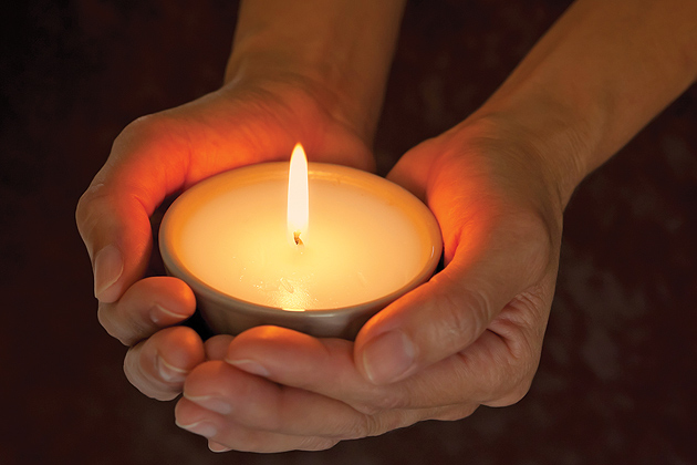 Candle being held in hands