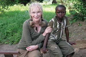 Actor and humanitarian Mia Farrow sits with a young Darfuri survivor of violence, 2007