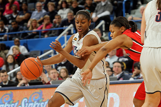 Tiffany Hayes '12 (CLAS) drives around a Rutgers defender during the Huskies' 49-34 win in the Big East Tournament quarterfinal at the XL Center on March 4. (Photo by Bob Stowell/Big East)