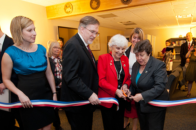 Caitlin Davies, left, '12 (CANR), John Saddlemire, vice president for student affairs, Gloria Hutchinson, federation of Women's Clubs of Connecticut, and Linda Schwartz, commissioner of the department of veterans' affairs, cut the ribbon to open the Student Veterans Oasis at the Student Union on March 21, 2012. (Peter Morenus/UConn Photo)