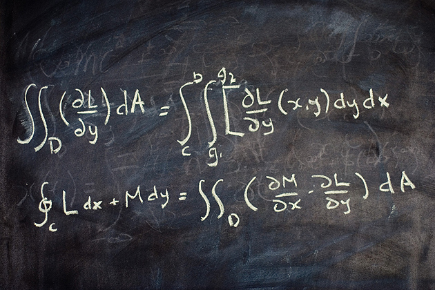 Calculus equation on a black board.