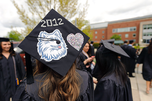 Melanie Cunha '12 (CLAS) wears a decorated cap before the early afternoon College of Liberal Arts and Sciences commencement ceremony held at Harry A. Gampel Pavilion on May 6, 2012. (Peter Morenus/UConn Photo)