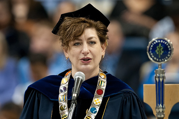 President Susan Herbst gives the address during the early afternoon CLAS commencement ceremony. (Peter Morenus/UConn Photo)