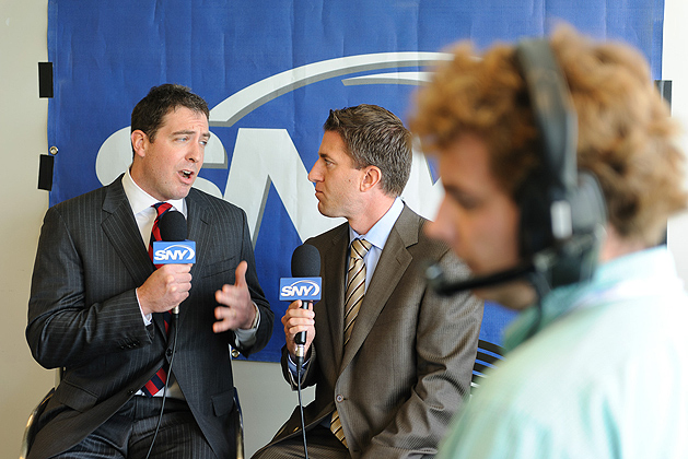 Sean Mulcahy, left, and Kevin Burkhardt announce the SNY broadcast of the UConn football Blue & White game. (Peter Morenus/UConn Photo)