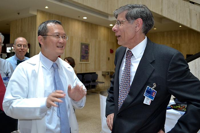 (left to right) Dr. Bruce Liang, head of cardiology who served as interim medical school dean, talks with the Health CenterÕs new executive vice president for health affairs and medical school dean, Dr. Frank Torti, during a welcome reception May 2. (Tina Encarnacion/UConn Health Center Photo)
