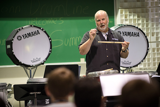 Matt Savage, director of percussion for the Jersey Surf Drum and Bugle Corps and the University of North Carolina demonstrates technique during the Yamaha Sounds of Summer held at the Music Building on June 26, 2012. (Peter Morenus/UConn Photo)