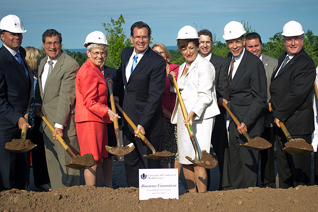From left: UConn Health Center Board of Directors Chair Sanford Cloud, State Sen. Gary LeBeau, Lt. Gov. Nancy Wyman, Gov. Dannel P. Malloy, UConn President Susan Herbst, UConn Health Center Executive VP for Health Affairs and Medical School Dean Frank Torti, and UConn School of Dental Medicine Dean R. Lamont MacNeil join in the groundbreaking...