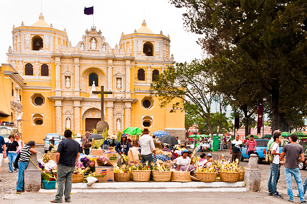 Antigua, Guatemala - April 17, 2011: Locals and visitors alike shop in the Semana Santa market in front of La Merced Cathedral.