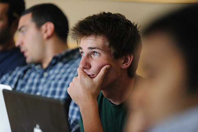 Tom Bachant '13 (ENG) listens to a mentor during a meeting of the iQ inQbator program at the Student Union on June 13, 2012. (Peter Morenus/UConn Photo)