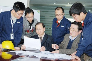 Qing Tang '94 Ph.D., third from left, vice president of ENN Solar Energy, works with his R&D team.