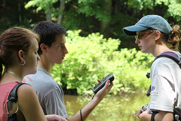 Ryan Clark, left, from Bolton and Harris Krizmanich, center, from Litchfield  work with Chelsea Blatchley as they take what they learned in the classroom out into the field. (Susan Schadt/UConn Photo)