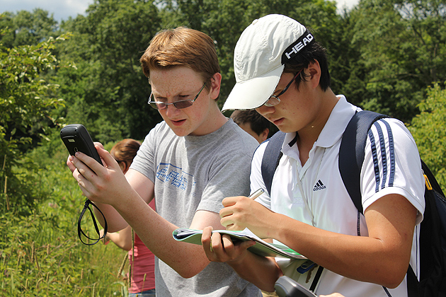 Grant Marsden from Tolland works with Meng (Fred) Lu from Beijing, China (by way of Kent, Conn.), checking coordinates. (Susan Schadt/UConn Photo)
