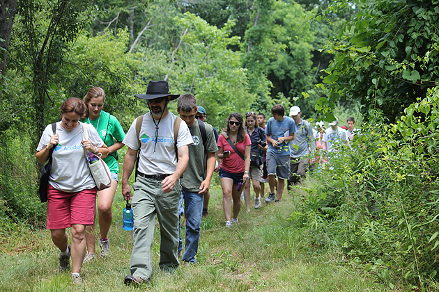 Emily Wilson, a cooperative extension educator, and John Volin, professor of natural resources and the environment, lead the students into the UConn Forest. (Susan Schadt/UConn Photo)