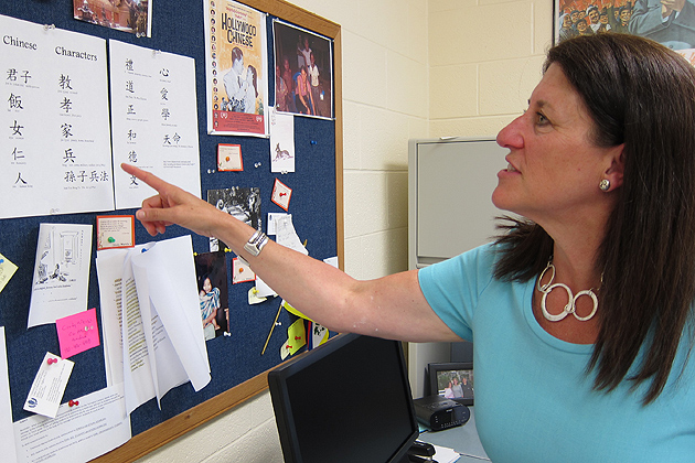 Christine Reardon in her office at the Torrington campus with Chinese Characters and books about East Asia. (Cindy Weiss/UConn Photo)