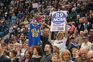 Fans celebrate the women's basketball team's record-breaking performance at the XL Center. The Huskies' 90-game winning streak from 2008 to 2010 was included in ESPN's 40-year timeline of 'Memorable Moments.' (Kenneth Best/UConn Photo)