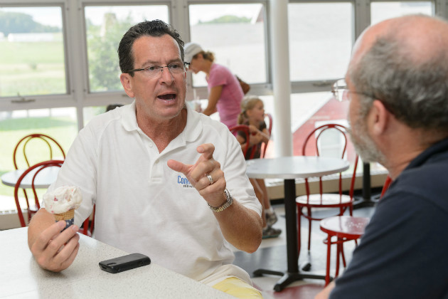 Gov. Malloy makes a point about Connecticut agriculture during his visit to the UConn Dairy Bar. (Peter Morenus/UConn Photo)