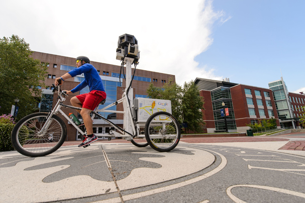 A Google employee takes photos with a tricycle-mounted camera apparatus to improve the Google Street View maps of campus. (Peter Morenus/UConn Photo)