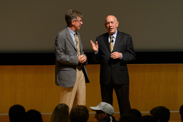 UConn alum Mike Soltys '81 (CLAS), left, ESPN's vice president of communications, engages in discussion with Bill Rasmussen, co-founder and first president and CEO of ESPN. (Peter Morenus/UConn Photo)
