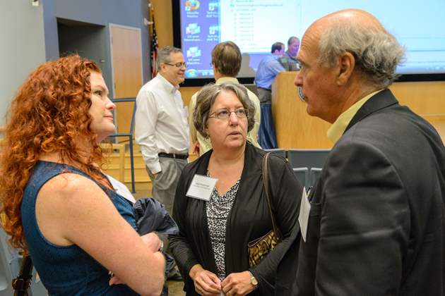 Rachel O'Neill, left, and Linda Strausbaugh, both professors of molecular and cell biology, and Marc Lalande. chair of genetic and developmental biology and senior associate dean for research planning and coordination at the UConn Health Center, speak between sessions of the symposium. (Peter Morenus/UConn Photo)