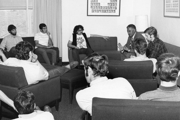 Whitney Young, executive director of the National Urban League, back right, speaks with UConn students during the first Metanoia in 1970.