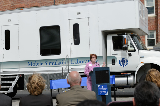 Regina Cusson, interim dean of nursing speaks at a ceremony to dedicate the Partnerships to Advance Nursing Practice's Mobile Simulation Laboratory outside Storrs Hall on Sept. 10, 2012. (Peter Morenus/UConn Photo)