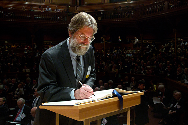 Michael North '76 MA, '81 Ph.D., Professor of English, University of California, Los Angeles, signs the American Academy of Arts and SciencesÕ Book of Members, a tradition that dates back to 1780.