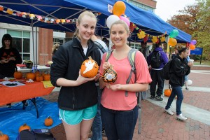 Stephanie Brady '16 (CLAS), left, and Maeve Maloney '16 (CLAS) show off their decorated pumpkins at Pumpkinfest on Fairfield Way on Oct. 26, 2012. (Ariel Dowski '14 (CLAS)/UConn Photo)