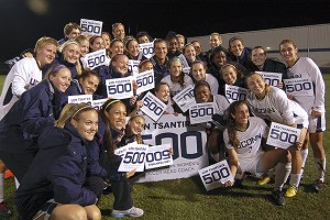 The women's soccer team celebrate the 500th career win of head coach Len Tsantiris at Morrone Stadium on Thursday, after the Huskies defeated Rutgers 3-1 in a first round game in the Big East Tournament. (Ken Best/UConn Photo)