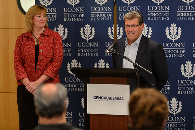 UConn Women's Basketball Head Coach Geno Auriemma announces a major new leadership conference to be held in April, during a press conference held at the School of Business this morning. At left is Lucy Gilson, associate professor of management and academic director of the Geno Auriemma-UConn Leadership Conference. (Peter Morenus/UConn Photo)