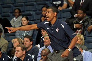 Men's head basketball coach Kevin Ollie '95 (CLAS) on the sidelines. (Bob Stowell '70 (CLAS) for UConn)