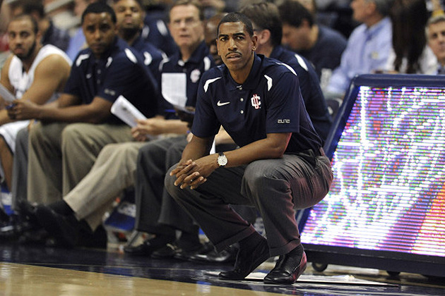 The Huskies know their coach always gives 100 percent. (Bob Stowell '70 (CLAS) for UConn)