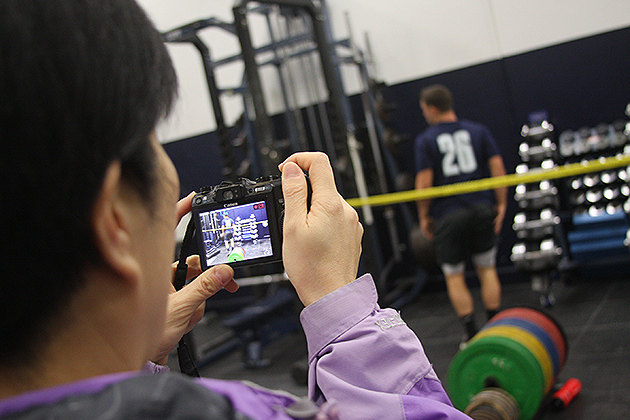The delegation watched members of the UConn baseball team work out in one of the training rooms at Gampel Pavilion. (Shawn Kornegay/UConn Photo)