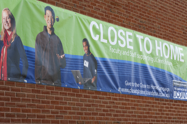 Pictures of the Close to Home banner hanging on the Student Union on Oct. 17, 2012. (Sean Flynn/UConn Photo)