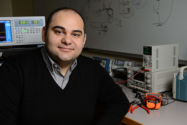 Ali Bazzi, assistant professor of electrical and computer engineering, at his lab. (Peter Morenus/UConn Photo)