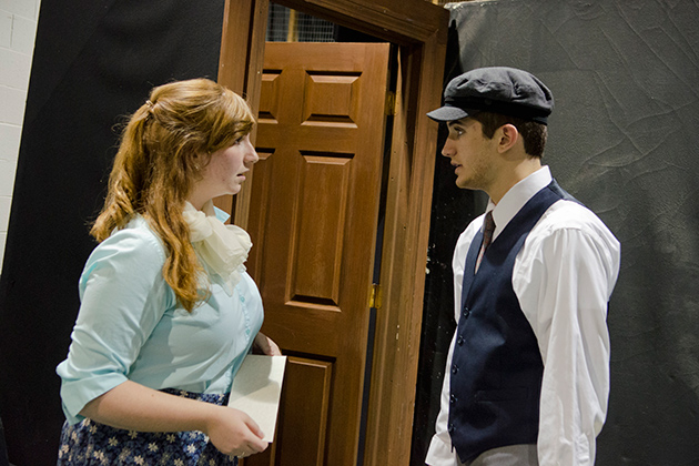 Noelle Currie '13 (SFA) and Ryan Parseghian '14 (SFA) act out a scene from 'Always Hope,' a work of historical fiction about the Holocaust. (Ariel Dowski '14 (CLAS)/UConn Photo)