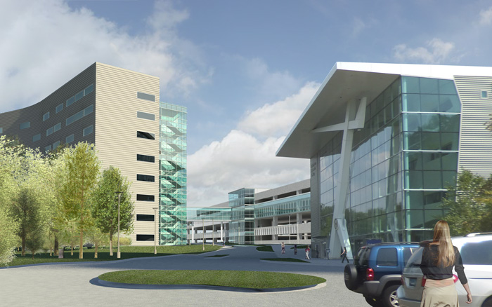 A rendered view of the parking garage across from the Ambulatory Care Center shows the bridge connecting the two buildings.