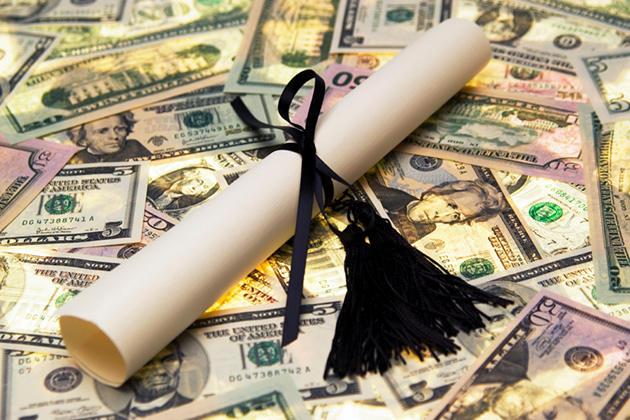 Diploma wrapped in black ribbon on top of money.