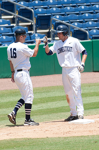 Head coach Jim Penders '94 (CLAS), '98 MA, left, with pitcher Ryan Moore '13 (CLAS). (Steve Slade '89 (SFA) for UConn)